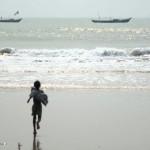 Boy running into sea